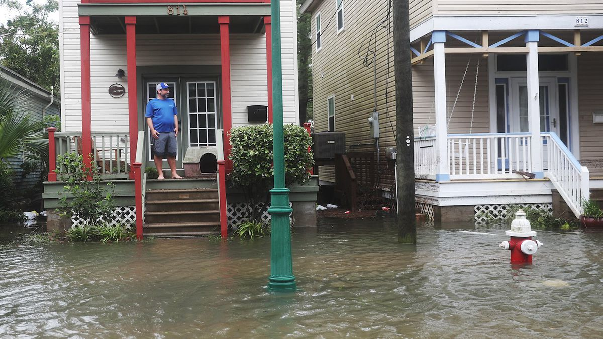 John Terrezza looks out at a flooded street in front of his home as Hurricane Sally passes through Pensacola on September 16, 2020.