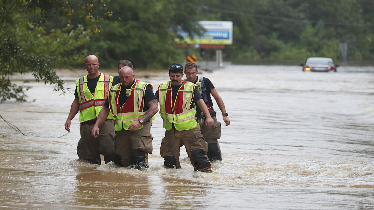 Members of the Pace Fire Rescue department wade through a flooded road after Hurricane Sally passed through Pensacola on September 16, 2020.